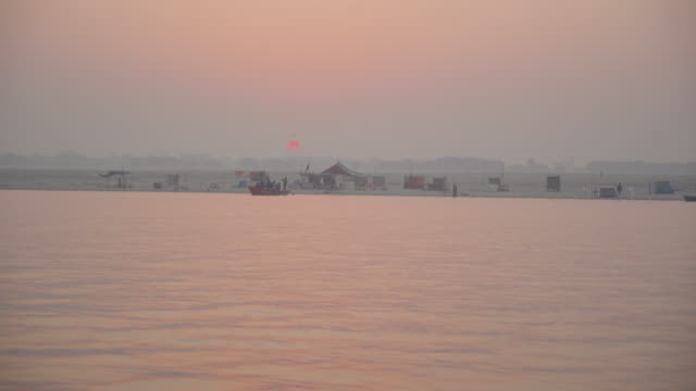 red sun rising on the ganges river - uttar pradesh stock videos and b-roll footage