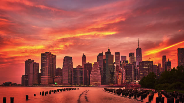 red sunset over manhattan downtown - orange colour stock videos & royalty-free footage