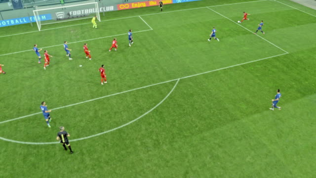 stockvideo's en b-roll-footage met aerial red team scoring at a football game - sportwedstrijd