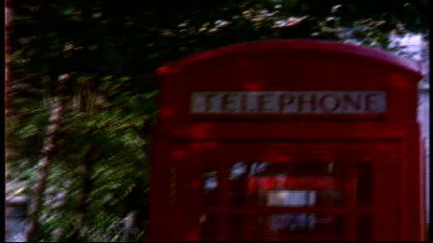 red telephone booths in london on super 8 film - telefonzelle stock-videos und b-roll-filmmaterial