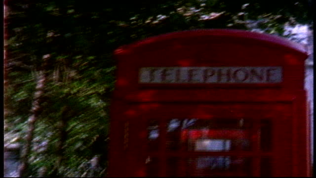 red telephone booths in london on super 8 film - 電話ボックス点の映像素材/bロール