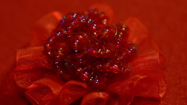 red tissue flower decorated with beads - hair accessory stock videos & royalty-free footage