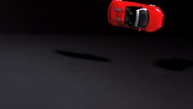 red toy car crashing into another - red convertible stock videos & royalty-free footage