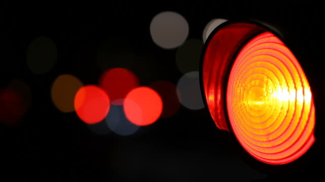 red traffic light in the night