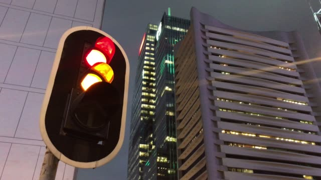 red traffic light turn into green, hong kong city - green light stock videos & royalty-free footage
