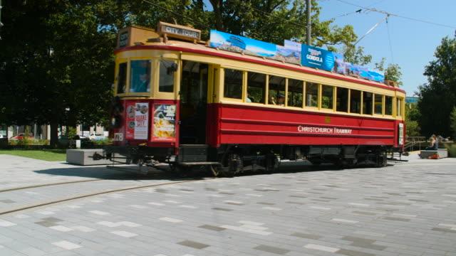 A red tram in Christchurch, New Zealand