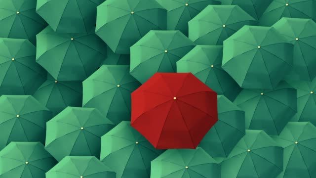 red umbrella standing out from crowd mass concept - individuality stock videos & royalty-free footage