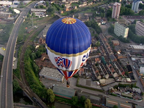red white and blue hot air balloon floating over city - bristol england stock videos & royalty-free footage