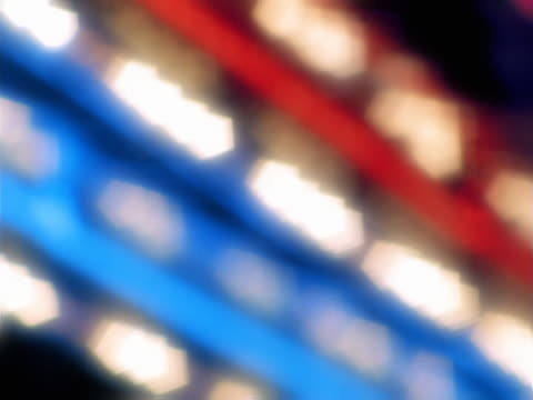 Red, white, and blue rows of blurred neon lights
