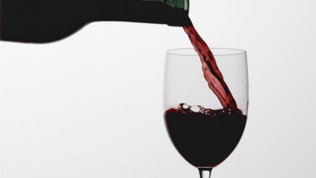 CU SLO MO Red wine being into wine glass / San Francisco, California, USA