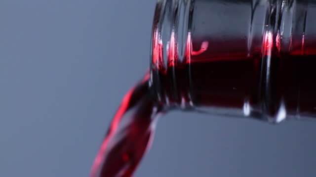 slo mo ecu red wine being poured from bottle - red wine stock videos & royalty-free footage