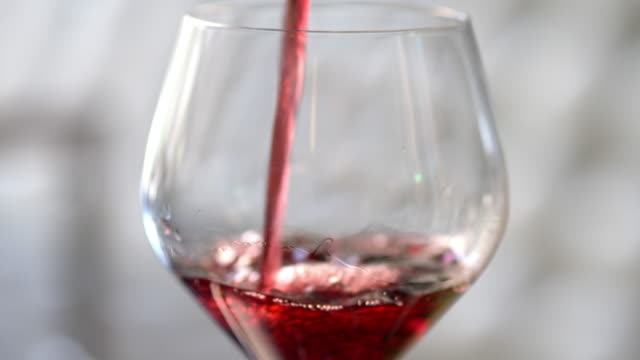 red wine being poured in to a wine glass. - wine stock videos & royalty-free footage