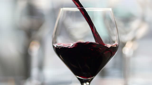 red wine being poured in to a wine glass. - coeliac disease stock videos & royalty-free footage