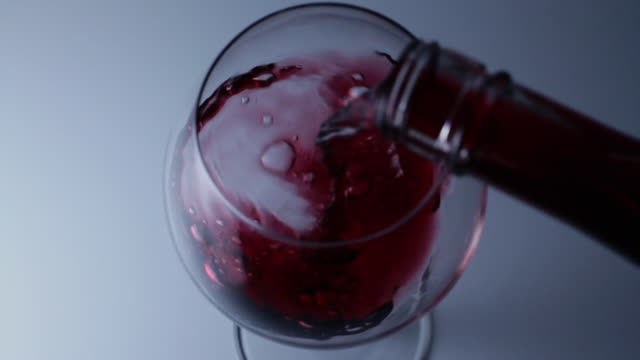 slo mo ha cu red wine being poured into glass - wine glass stock videos and b-roll footage