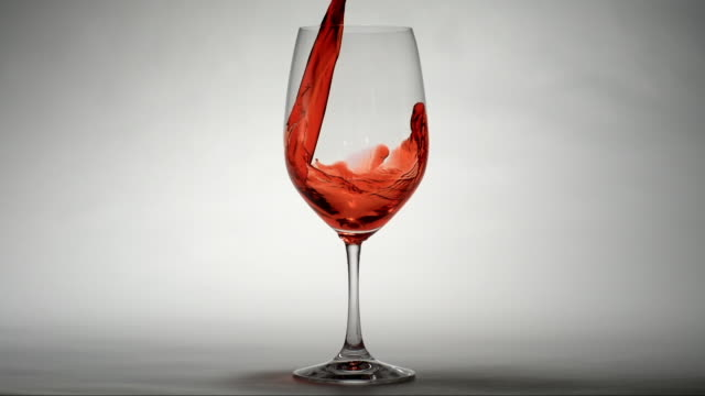 red wine pouring into a glass - wine glass stock videos and b-roll footage