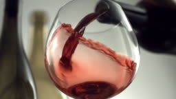 Red wine pouring, slow motion