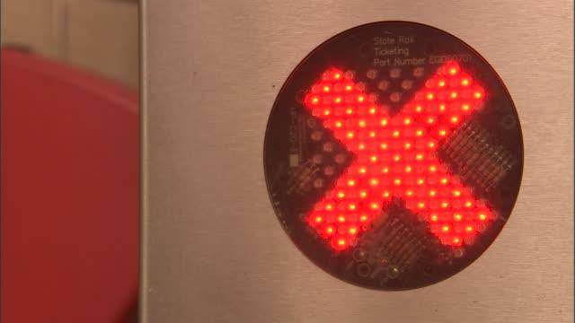 CU, Red X sign and arrow sign on train station turnstile, Olympic Park railway station, Sydney, Australia
