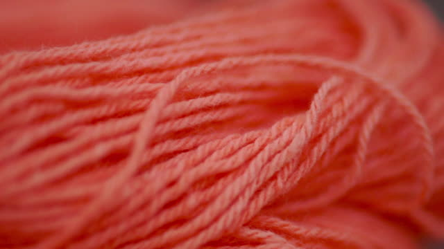 red yarn wool with natural dye for embroidery and knitting. - ball of wool stock videos & royalty-free footage