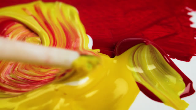 red, yellow and white paints mixed together - creativity stock videos & royalty-free footage