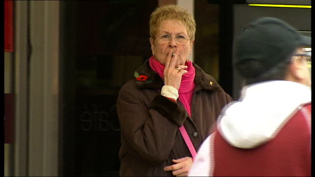 Redbridge Council announces plans to ban smokers from becoming foster carers Shoppers along woman along smoking a cigarette woman looking in shop...