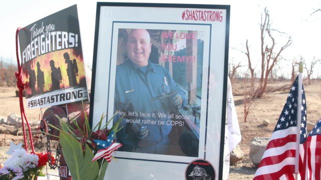 redding, california, usa: a memorial for redding firefighter jeremy stoke, 37 years old, is erected along buenaventura boulevard where he died after... - 2018 stock videos & royalty-free footage