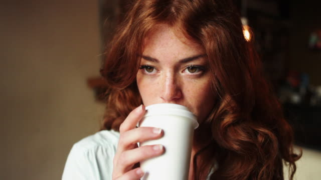 red-haired woman having a cup of coffee - bar stock videos & royalty-free footage