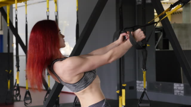 redhead fitness woman training with trx fitness straps - shirtless stock videos & royalty-free footage