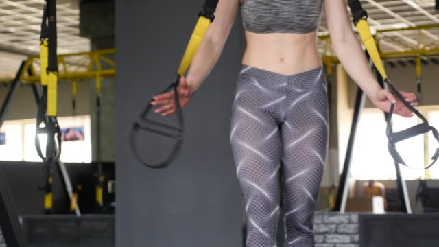 redhead fitness woman training with trx fitness straps - sports commentator stock videos & royalty-free footage
