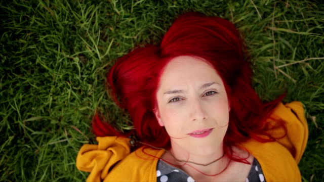 redhead girl lying on the grass - lying on back stock videos and b-roll footage