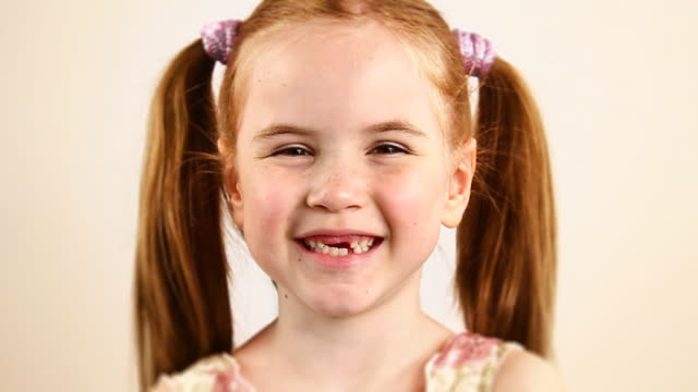 redhead little girl laughing - hd, ntsc - studio shot stock videos & royalty-free footage
