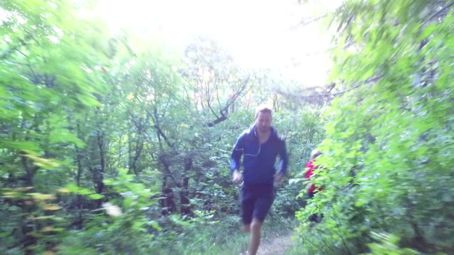 redhead man and blonde woman running through wood - running shorts stock videos & royalty-free footage