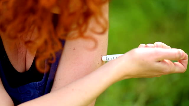 redheaded woman making arm subcutaneous insulin syringe injection - diabetes prevention stock videos & royalty-free footage