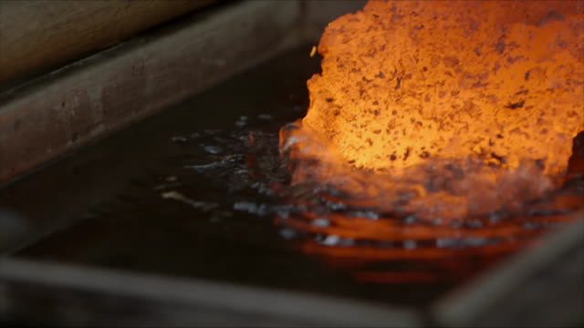 red-hot metal is dipped into water by a bladesmith - removing stock videos & royalty-free footage