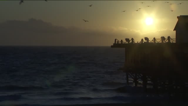 ktla redondo beach ca us empty pier and beach closed due to coronavirus pandemic on sunday march 29 2020 - twilight stock videos & royalty-free footage