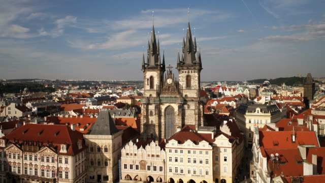 red-roofed buildings surround tyn church. - stare mesto stock videos and b-roll footage
