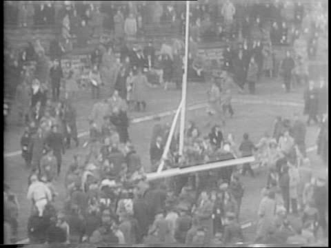 redskins sammy baugh throws interception to charlie avedisian / avedisian running in touchdown to win 31-0 / crowd storming field / fans tearing down... - nfc east stock videos & royalty-free footage