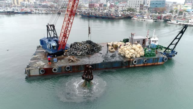 reducing floating marine litter at mokpo port / mokpo-si, jeollanam-do, south korea - marina stock videos & royalty-free footage
