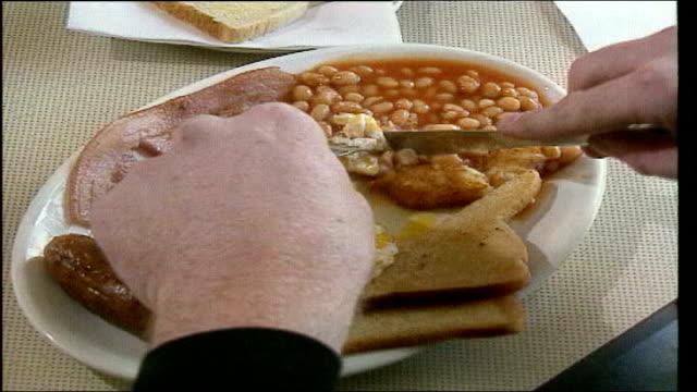 reduction in heart disease deaths lib cs fried breakfast on plate as eaten chips from frier into bag in chip shop ms man smoking tilt - eaten stock videos & royalty-free footage