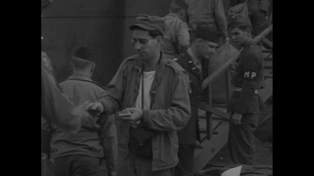 reel indicator roll 3 wong / vs us soldiers and sailors wait on pier as they prepare to depart shanghai / vs soldiers with duffel bags start to board... - hands behind head stock videos and b-roll footage
