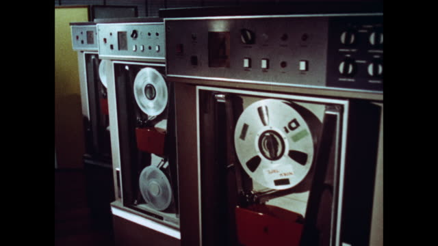 PAN Reel to reel work tapes spinning in six large machines / United Kingdom