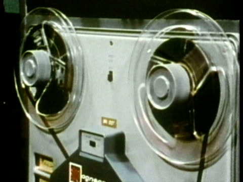 1969 CU Reel-to-reel tape recorder playing in sound booth during hearing test/ USA/ AUDIO