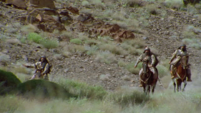 ws pan reenactment crusaders riding on horseback through valley / iran - the crusades stock videos & royalty-free footage