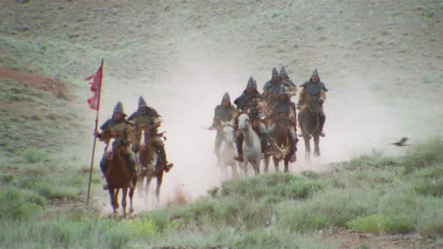 ws cu reenactment crusaders riding on horseback with flag through valley / iran - the crusades stock videos & royalty-free footage