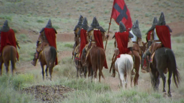 ws tu reenactment crusaders riding on horseback with flag through valley / iran - the crusades stock videos & royalty-free footage