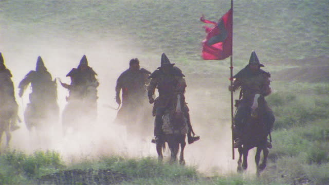ws ms tu reenactment crusaders riding on horseback with flag through valley / iran - the crusades stock videos & royalty-free footage