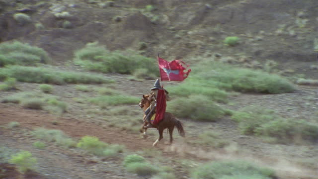ha ws pan reenactment crusaders riding on horseback with flag through valley / iran - the crusades stock videos & royalty-free footage