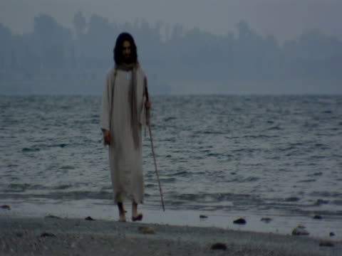 a reenactment depicts jesus christ walking on the shore of the sea of galilee. - biblical event stock videos & royalty-free footage