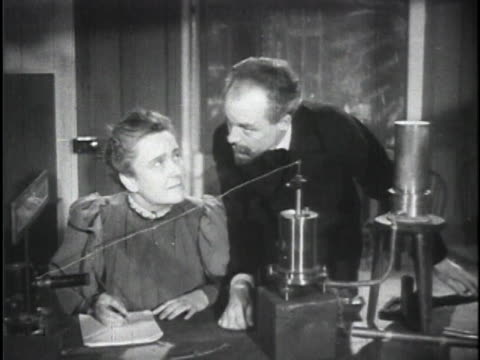 reenactment henri becquerel and marie and pierre curie working in their labs ernest rutherford speaking diagram of atom construction - biology stock videos & royalty-free footage