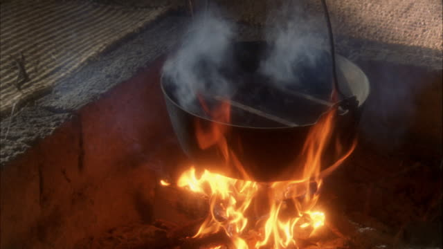 reenactment high angle close up iron pot hangin over open flame / japan - 16th century style stock videos & royalty-free footage