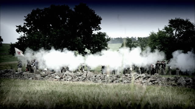 MS Reenactment Line of soldiers fire rifles at Battle of Gettysburg